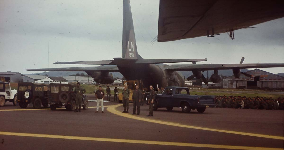 An RNZAF No. 41 Squadron Bristol Freighter taxies into Cam Ranh Bay Naval Base. Note the group of Viet Cong prisoners at right. © Colin Creighton.
