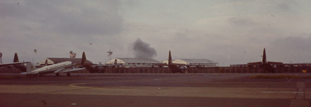 Colin and crew land at Saigon's Tan Son Nhat International Airport to observe part of the airport under attack from Viet Cong missiles. © Colin Creighton.